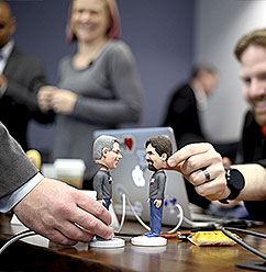 Employees playing with bobble heads